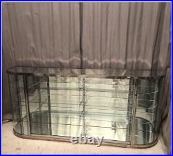 Paire de vitrines anciennes de magasin, laiton chromé et verre bombé OLLIER